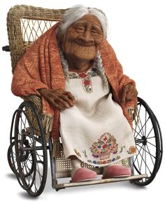Socorro, better known as Mamá Coco, is the titular character in the Disney/Pixar film Coco. She is a warm-hearted, supportive and kind woman who is Miguel's great-grandmother. She suffers from a degenerating memory, but doesn't let that interfere with her happiness. Mamá Coco is introduced as the daughter of Imelda and an unnamed musician who left Imelda with Coco after the latter decided to pursue a career in music. Because of this, Imelda enforced a ban on music in her family and r...