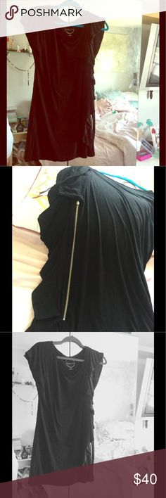 """NWOT INC Black Top with Ruffles going down in XL This shirt is beautiful in a Short sleeve with a side zipper for design and beautiful Ruffles going down the left side.  The zipper actually opens too.  This is 33"""" in length and stretchy.  Material is 95% Rayon and 5% Spandex INC International Concepts Tops Blouses"""