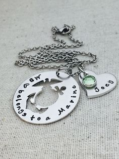 This listing includes a 1 1/4 18 gauge silver aluminum washer with EGA cutout center hand stamped with My heart belongs to a Marine on your choice of stainless steel chain or key chain. Optional purchase of a 3/4 silver aluminum 14 gauge heart stamped with name and Swarovski