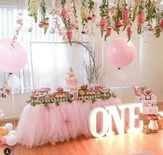 Giant pink balloons set the stage for a beautiful party. #babyshowerideas #princessparty