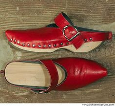 Zabot red    Julia Lipinsky    ZABOT combines the look of Scandinavian wooden clogs and the shape of elegant and narrow cowgirl-boots with the objective to create sandals with pointed and closed toe-caps which are producing inimitable silhouettes.