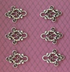 """Ornamental Lacing Grommets  Traditionally used in folk costumes (e.g. Dirndl and similar dress styles) our ornamental grommets are the perfect choice for fancy lacings on 18th C. dresses to victorian waists, etc. Also called """"Miederhaken"""" or """"Dirndlhaken""""."""