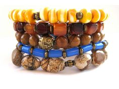 Eclectic beaded stretch bracelets (5 in all!) featuring 7 and 8mm yellow and white carved bone beads, picture jasper chunks, horn beads, 8mm wood jasper beads, blue glass fulani funeral beads and antiqued goldtone accent beads. A fun, flirty arm party that is sure to draw rave reviews any time you wear it. Wear stacked or mix and match with other Rock & Hardware bracelets. The fun has only just begun! Handmade by Rock & Hardware Jewelry
