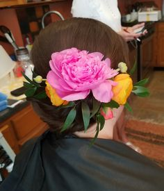 Low chignon with flower crown for the bride, by Shana Montgomery owner of Fringe Theory Salon.