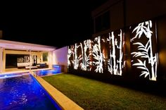 Bamboo tree corten steel light panel by Lump Sculpture Studio