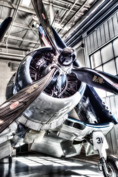 This image of the Corsair, with folded wings, is a HDR image created from three separate photos spanning +/- 2 f-stops of exposure. Photomatix Pro was used for HDR processing with additional toning accomplished with Nik Software's Color Efex Pro. I am very pleased with the detail of the engine on this magnificent aircraft.