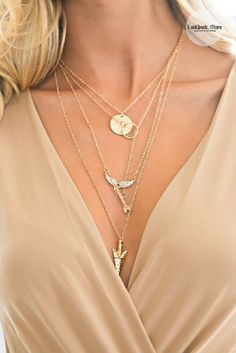 This gorgeous four-chain gold necklace looks best when layered together with your favorite LBDs or cocktail dresses. Shop one here.