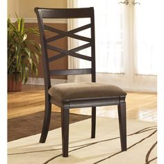 Incorporate contemporary style into your dining room or living area with the sophisticated Hayley side chair. Finished in dark brown, this modern chair features a unique double X-back design with a plush brown seat to provide comfortable seating.