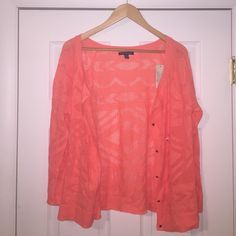 Bright Orange American Eagle Cardigan This cardigan is NWT! Never worn & in PERFECT condition! Color is bright orange with lace-like detailing! Super bright & perfect for spring! American Eagle Outfitters Sweaters Cardigans