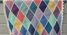 Here's my harlequin blanket. I have seen a few here and there, and I have made rhombuses (or diamonds if you like)  before …  This time I ...