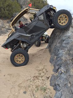 """2016 Polaris RZR 1000 Turbo built by Vent Racing. It has a custom height Vent Racing Trucker cage, custom roof with 126 3"""" louvers, single row LED light bar, full windshield, low-pro front bumper, Aero slip-on exhaust, Zbroz Racing ARSFX 2""""+ front A-arms and high clearance rear radius rods, Pro Armor lower doors, custom black and gold Venom bucket seats by Triple X, 15x7 Sedona Badland wheels, 31x10.5x15 Dick Cepek Extreme Country tires, with custom gold powder coat."""