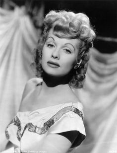 Lucille Ball, circa 1945: Studio portrait of American actor and comedian Lucille Ball wearing an off-the-shoulder dress. (Photo by MGM Studios/MGM Studios/Getty Images) #hollywood