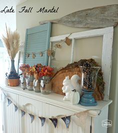 late fall mantel with burlap and feather wrapped mason jars and wood round at thehappyhousie
