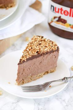 This is the ULTIMATE No Bake Nutella Cheesecake. Incredibly easy and utterly delicious. This chocolate and hazelnut delight is a must make for Nutella fans! Light and creamy, with a buttery biscuit base and roasted hazelnut topping. Look no further for THE best Nutella cheesecake recipe.