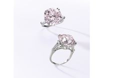 A 10.11-carat VS2 brilliant cut fancy light pink diamond set into a ring realized $3.9 million, or $393,071 per carat, setting a world auction record for price per carat for a fancy light pink diamond.