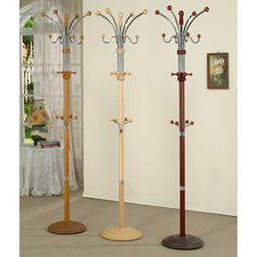 @Overstock.com - Metal and Wood Standing Coat Rack - Available in a lovely natural, oak, or cherry finish, this metal-and-wood standing coat rack offers an elegant way to store items including coats, hats, and scarves. There are eight small arms and eight larger arms available for use.  http://www.overstock.com/Home-Garden/Metal-and-Wood-Standing-Coat-Rack/8061579/product.html?CID=214117 $55.99