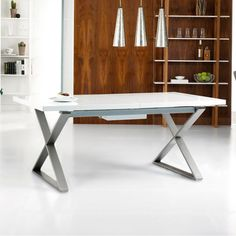 The steel cross base of this table complements the high gloss finish. The table easily extends, thanks to an internally stored mechanism so it can accommodate 10 easily within a couple of seconds.