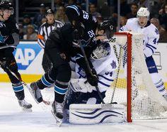 San Jose Sharks forward Tye McGinn collides with Toronto Maple Leafs goaltender James Reimer (Jan. 15, 2015).