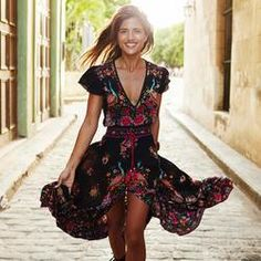 BellFlower Dress  Flowing and floral this stunning romantic dress is flirtatious with its many details.  This dress has a deep V-neck, split front leg, and is longer in back.  The tassel tie, peacocks and flared short sleeves add the perfect touches.