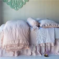 Pink ruffled bolster, ruffled pillows and comforter. #bella notte linens. I'm going to get mine in a cream color.