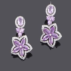 A pair of pink sapphire and diamond pendent earrings.  Bonhams  (=)