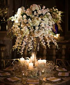 Elegant wedding centerpieces with candles, roses, hydrangeas and orchids