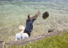 working inside lake attersee / upper austria, stone throws