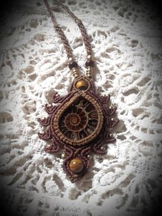 Macrame Necklace ammonite fossil and tigereye brown earthy tribal spiral sun Makramee amulet hippie ethno goa by MagicKnots on Etsy https://www.etsy.com/listing/459678870/macrame-necklace-ammonite-fossil-and