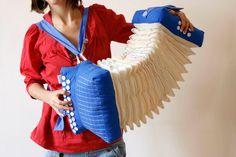 Soundless play blue fabric accordion rainbow embroidered bellow art object - accordéon silencieux bleu soufflet brodé arc enciel. €300,00, via Etsy.