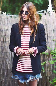 Distressed denim boyfriend shorts worn with a red striped shirt and a navy blazer