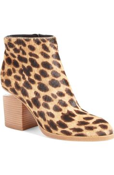 Adding exotic edge to this signature Alexander Wang bootie with leopard-spotted calf hair.