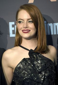 Emma Stone Photos Photos - Actress Emma Stone poses in the press room during The 22nd Annual Critics' Choice Awards at Barker Hangar on December 11, 2016 in Santa Monica, California. - The 22nd Annual Critics' Choice Awards - Press Room