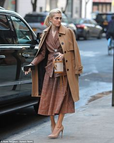 'It feels like we just broke up': The actress, who draped a camel coat over her shoulders,...