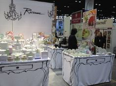 The beautiful Rosanna booth, love the handrawn tables on plain white fitted cloths.