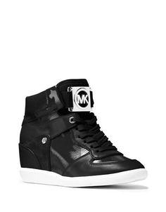 """<ul><li>Stylish high-top sneakers with front logo emblem</li> <li>Hidden wedge heel, 3""""</li> <li>Patent/suede/nappa leather upper</li> <li>Lace-up closure</li> <li>Synthetic lining</li> <li>Rubber sole</li> <li>Padded insole</li> <li>Imported</li></ul>"""