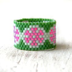 Flower beaded ring. Wide band ring. Hippie style ring. This ring made with Miyuki delica seed beads.  Band width - 15 mm Size - 10 3/4 (US)  More peyote rings (seed bead rings) from my shop you can see here: https://www.etsy.com/shop/HappyBeadwork?section_id=18818205