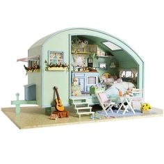 A Boho Dollhouse Kit!  DIY wooden kit to assemble and build yourself. I am in love! Comes with all in picture!