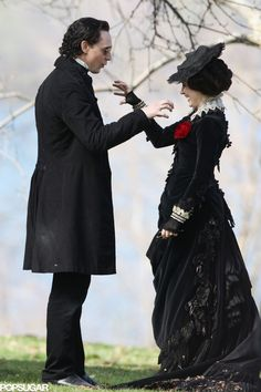 Tom Hiddleston and Jessica Chastain got goofy on the set of their new film, Crimson Peak, in Toronto on Tuesday. The two friends, who were dressed in black Jessica Chastain, Tom Hiddleston Crimson Peak, Tom Hiddleston Loki, Tim Burton, Thomas Sharpe, Chef D Oeuvre, Movie Costumes, Celebrity Gossip, Gotham