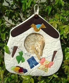 birdhouse clothespin holder ... I was thinking of the baby clothes one but this is really cute too ... (it would also make a cute potholder!)