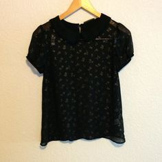 Sheer Black Top This pretty black top is sheer with a collar and gold rose print Vera Wang Tops Blouses