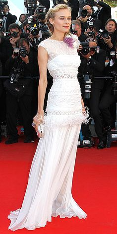Cannes 2012: Diane Kruger in a white embroidered and feathered Nina Ricci gown...stunning! Love the braided iPod