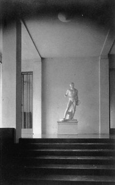 Looking up the short flight of stairs in the entrance hall of the Wittgenstein House. Although no architect Wittgenstein together with Paul Engelmann found the perfect balance between classical and modern architectural elements to create a timeless mastepiece.