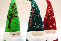 felt gnomes. love their embroidered hats.