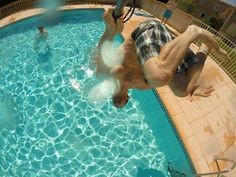 Side flip into the pool. GoPro