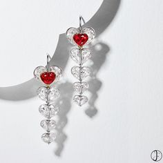 Of cascading heart-shaped motif featuring two unheated rubies decorated by pear-shaped diamonds. Of cascading heart-shaped motif featuring two unheated rubies decorated by pear-shaped diamonds. Lotus Jewelry, Ruby Jewelry, Ruby Earrings, High Jewelry, Jewelery, Dangle Earrings, Diamond Earrings, Pear Shaped Diamond, Diamond Shapes
