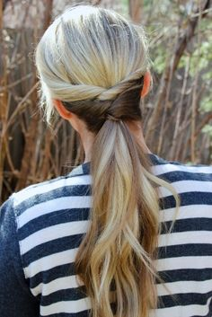 This is the popular style Blair Waldorf wore in Gossip Girl a little while back. (Layered twists and 5 ponytail holders. Not hard to do )
