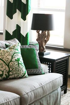 In serious love with those green and white cheveron curtains!!!!!!!! and the pillows, couch, lamp, side table...