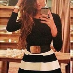 black long sleeve dress with striped skirt