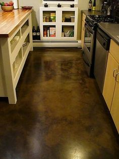 Paint, Polish, or Acid-Stain Your Concrete Floors - Pictures of Concrete Flooring Surface Treatments: Mottled Brown Stained Concrete Kitchen Floor - Stained Cement Floors, Concrete Kitchen Floor, Cement Stain, Concrete Shower, Diy Concrete, Painted Floors, Concrete Countertops, Clean Concrete, Floor Stain
