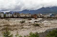 Houses on the edge of Cougar Creek, in Canmore.Photograph: John Gibson/Getty Images